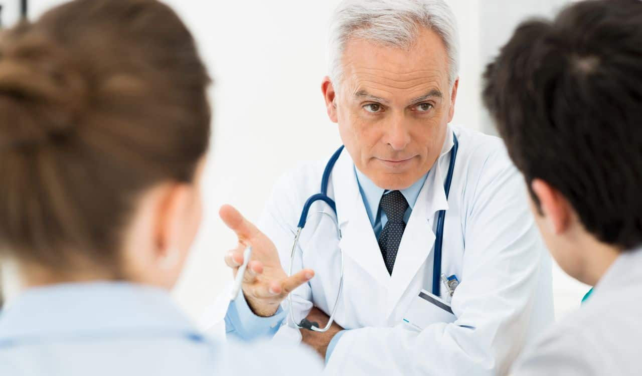 Doctor Discussing With Patients