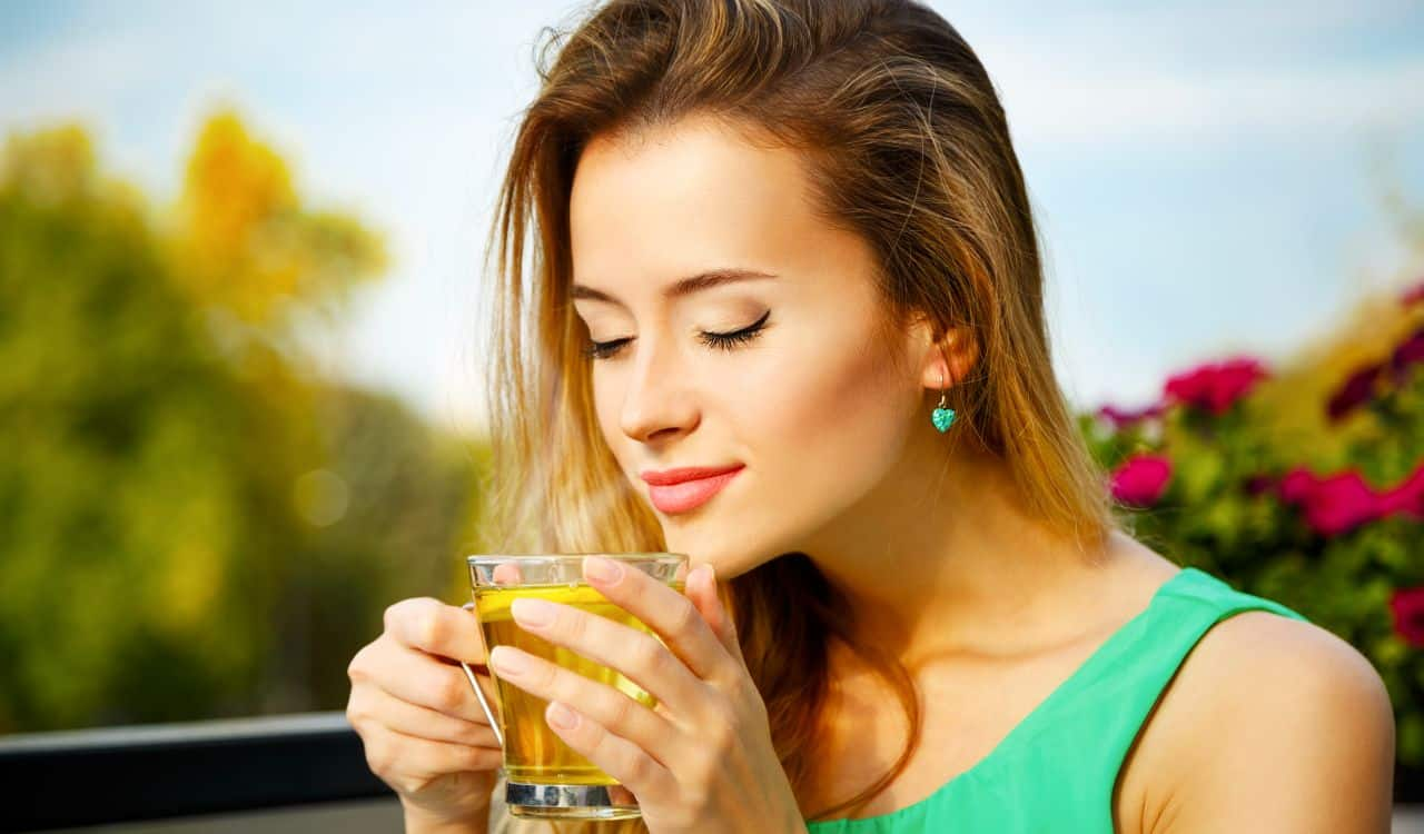 Woman Drinking White Tea