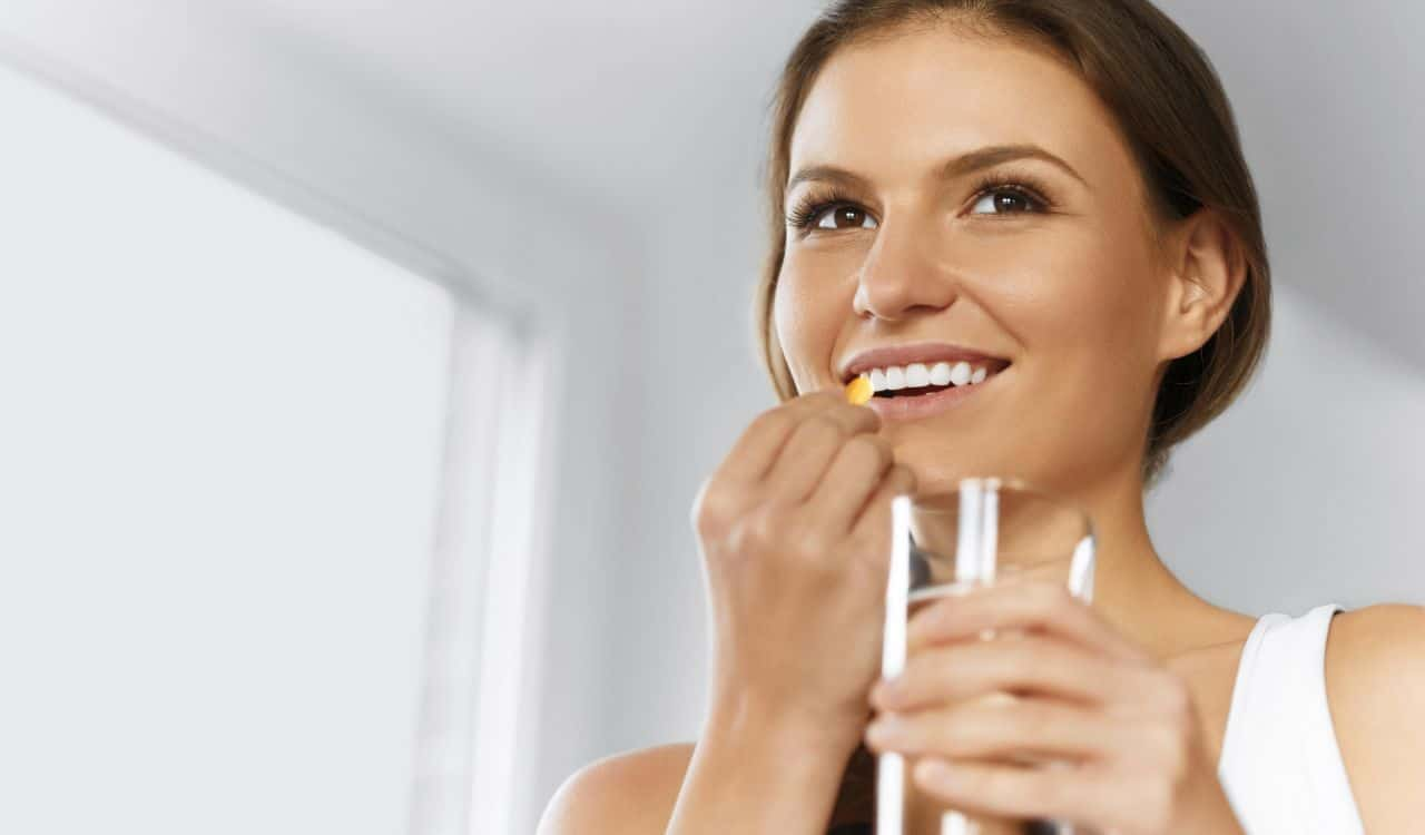 Woman Takes Hyaluronic Acid Supplement