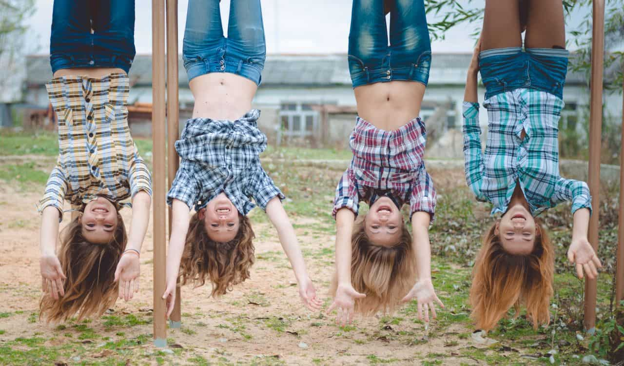 Girls Hanging Upside Down