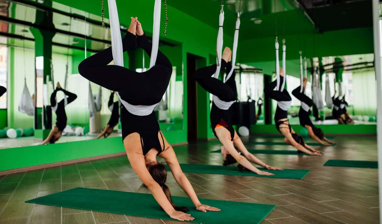 Woman Using Inversion Swings