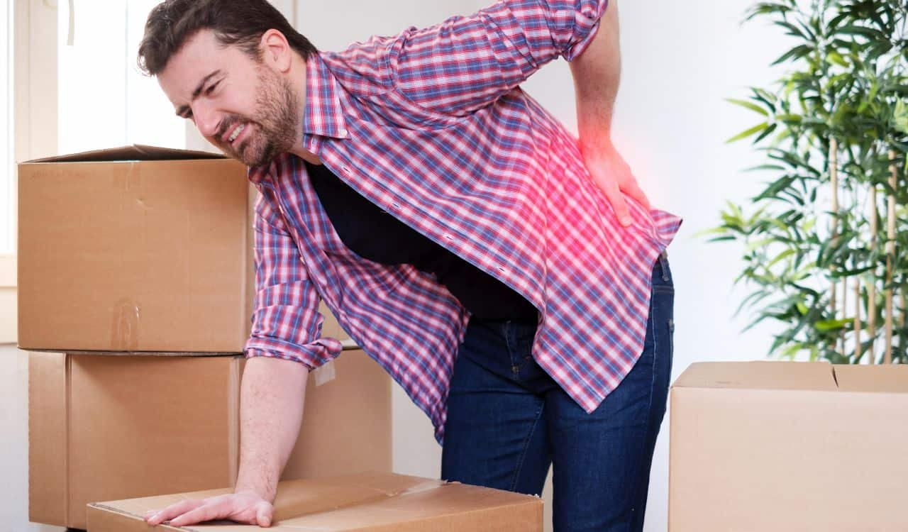 Man Suffering Back Pain During Moving Things
