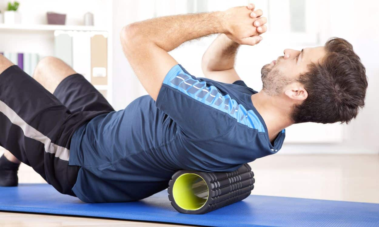Man Uses Foam Roller For Back Pain Relief