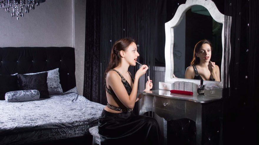 Glamorous Young Woman Applying Makeup