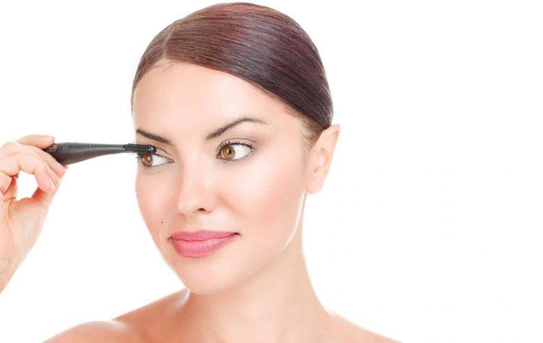 Woman Uses Heated Eyelash Curlers
