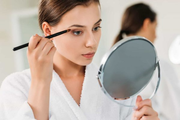 Woman Holding The Makeup Mirror
