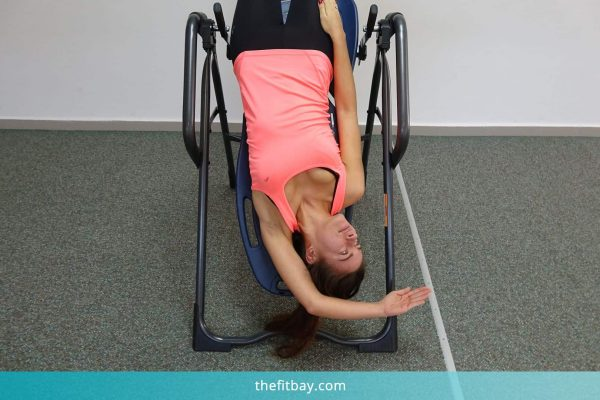 Young Woman Practicing On Inversion Table