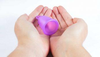 menstrual cups in hands