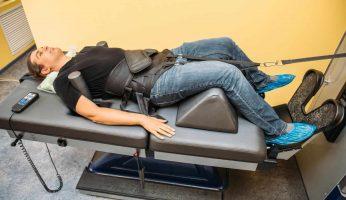 Man Treats Back Pain Using Traction