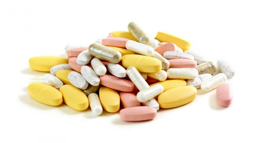 Vitamin pills and capsules