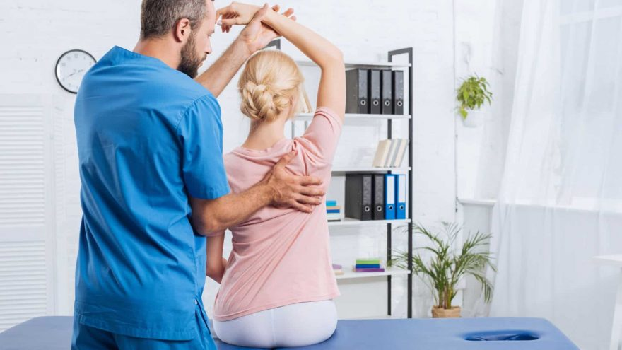 Therapist Treats Patient With Back Pain