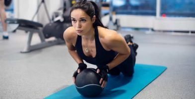 Woman Exercises With Medicine Ball
